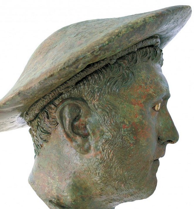 "4 of 16 Full Screen Identified simply as ""Portrait of a Man,"" this bronze head is displayed in a room devoted to Alexander the Great, and his peers and successors. The hat, known as a kausia, was often found in images used on coins as an identifying mark of Macedonian general or king. Hellenic Ministry of Culture, Education, and Religious Affairs/Archaeological Museum of Kalymnos"