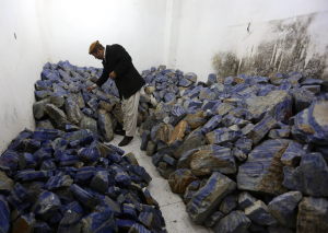 An Afghan businessman checked lapis lazuli at his shop in Kabul in March. Afghanistan has long been one of the chief sources of lapis lazuli, a prized gemstone associated with love and purity. Credit Rahmat Gul/Associated Press