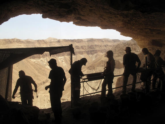 Volunteers working alongside Israeli archaeologists sift the dirt in the Cave of Skulls in the Judaean wilderness. (William Booth/The Washington Post)