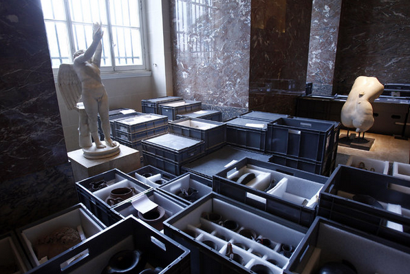 Artworks were packed to be moved from the Louvre Museum's storeroom to the exhibition halls, where they would be less vulnerable to rising flood waters. Credit Thierry Chesnot/Getty Images