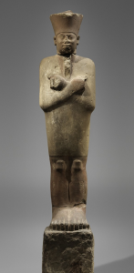 Nebhepetre Mentuhotep II, an 11th Dynasty king, is credited with reunifying Egypt and establishing the Middle Kingdom. This statue, in a deliberately archaic style, is actually pieced together from two similar works that once stood at the king's temple at Deir el-Bahri. Metropolitan Museum of Art)